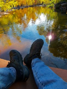 rest-hiking boots at waterside